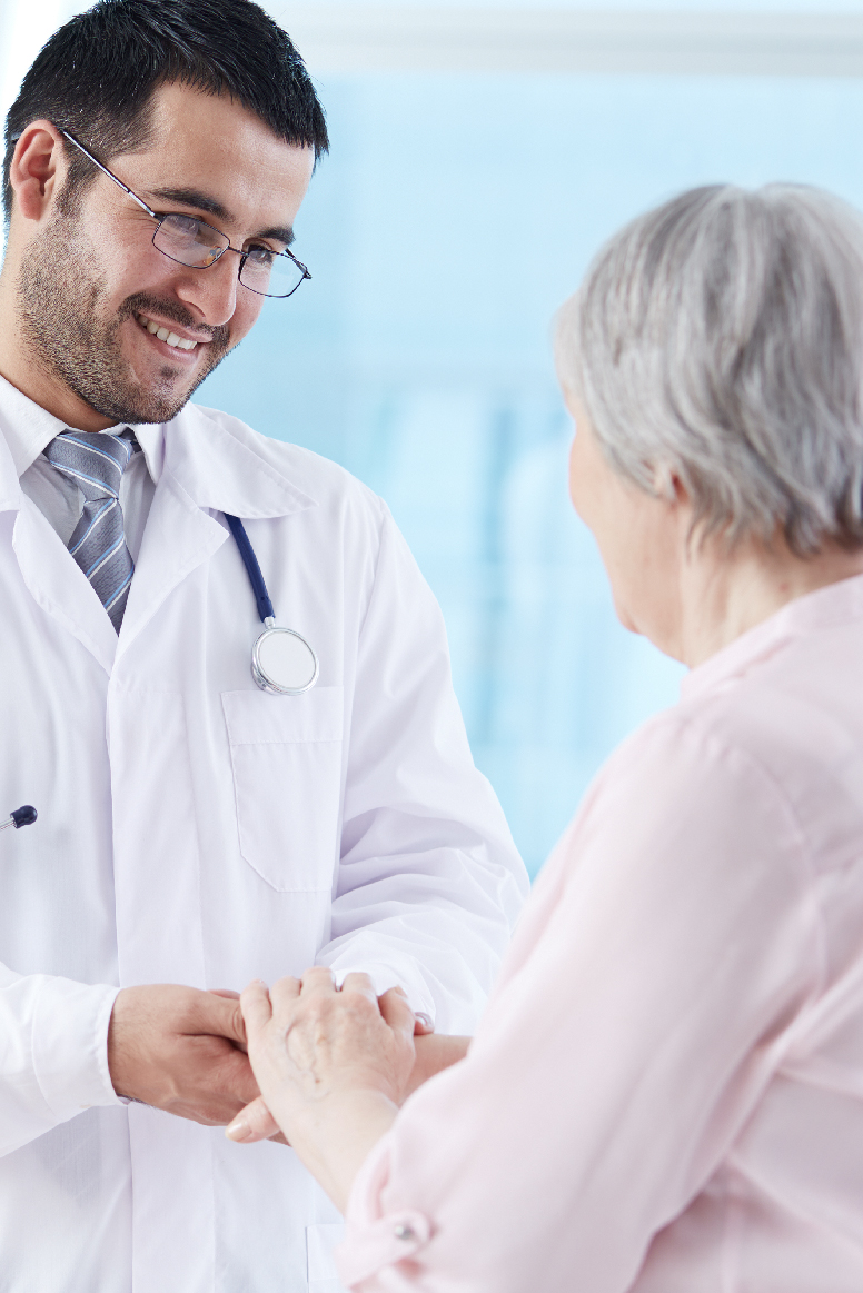 elderly patient talking to her doctor about her health