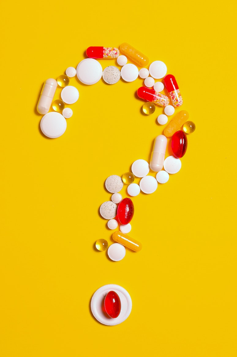 Pills on a yellow background