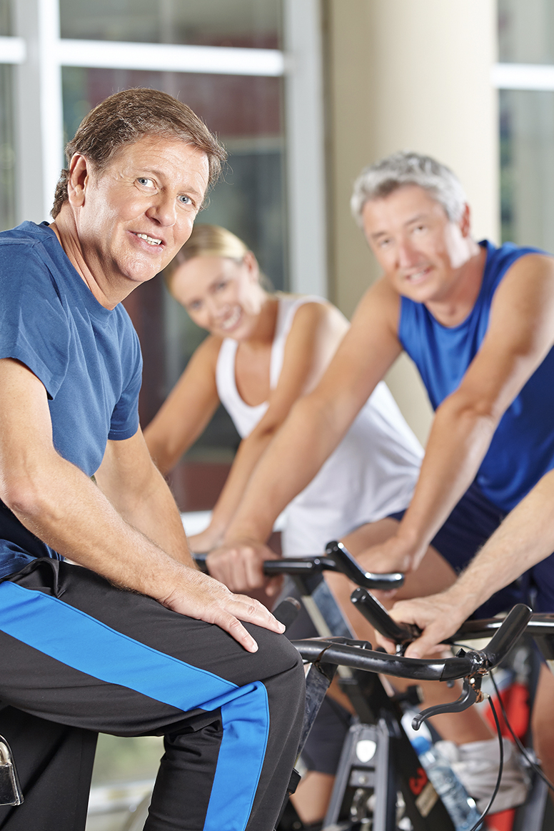 group of people workout out on bikes
